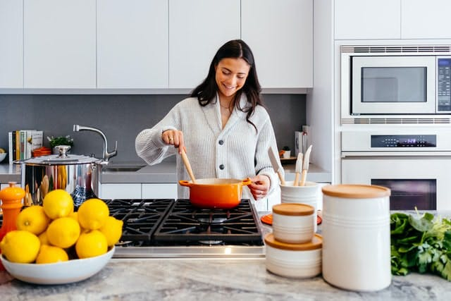 person cooking in kitchen