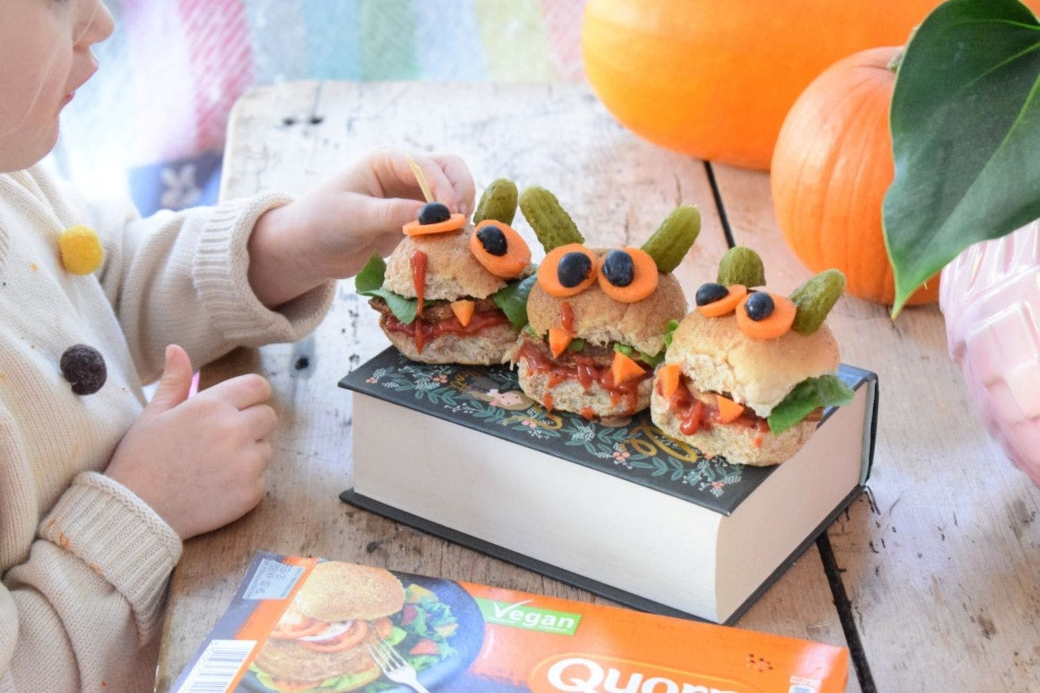 three quorn monster burgers with child
