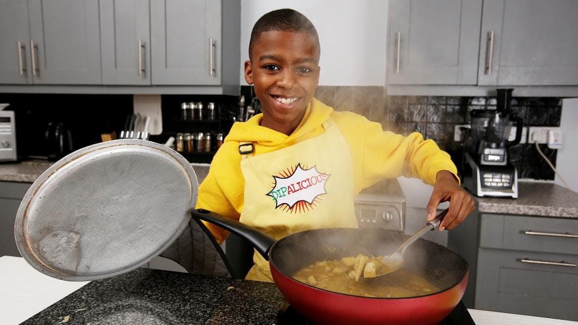 Che Omar McQueen in kitchen