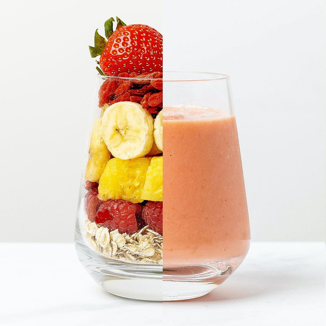 glass half of smoothie and half contain fruit
