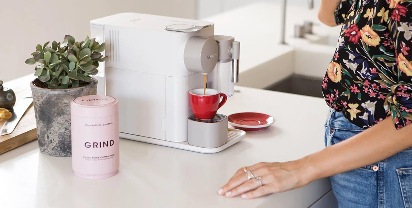espresso pod machine in use