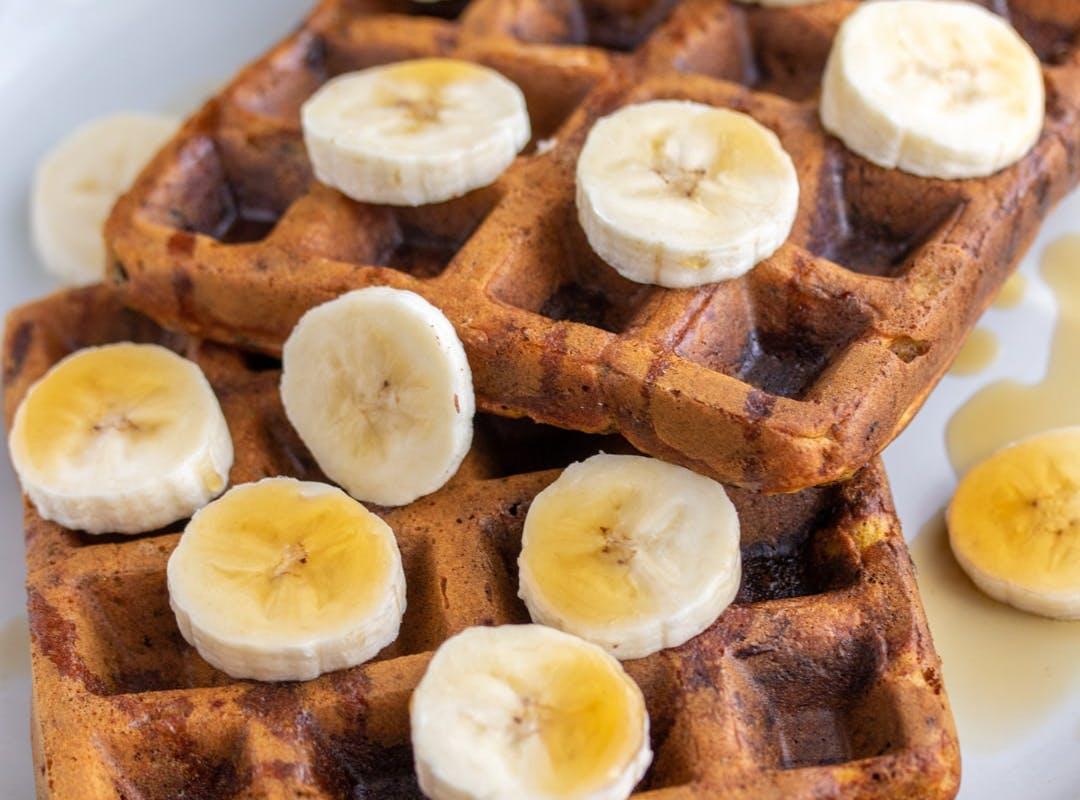 vegan waffles covered in banana
