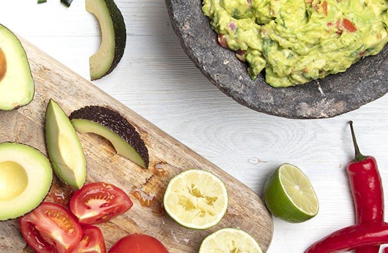Avocado and guacamole on table