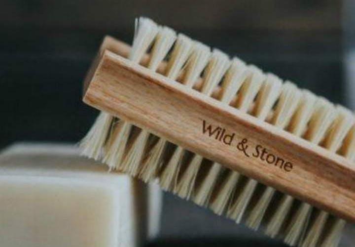 a wooden nail brush