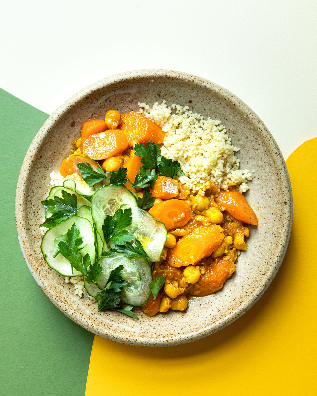 carrot chickpea tagine on white yellow and green background