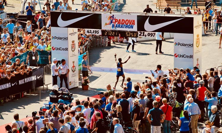marathon finisher crossing the line