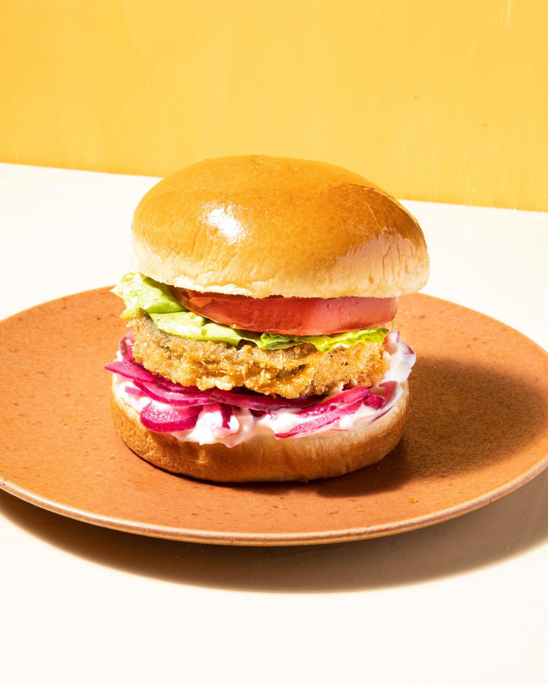 aubergine burger on plate
