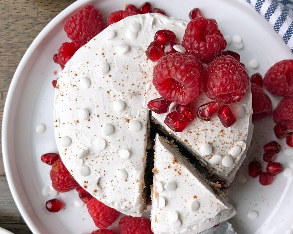 smash cake opped with raspberries