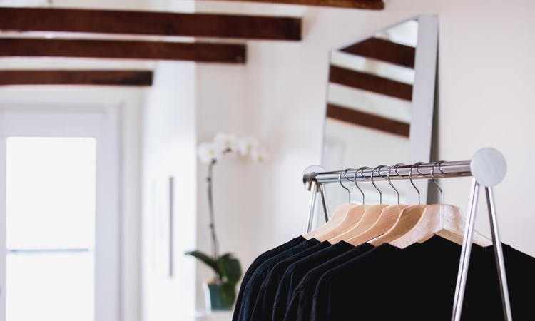 black clothing on a rail in a store