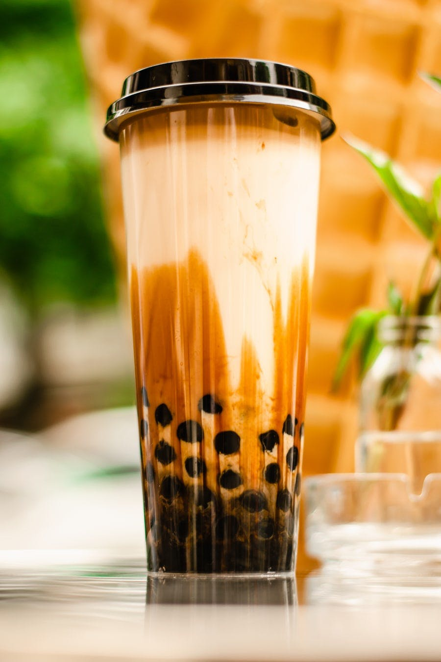 tall glass of bubble tea with boba