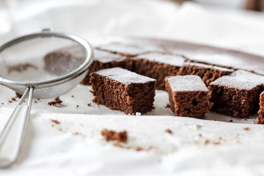 brownies dusted with sugar with sieve