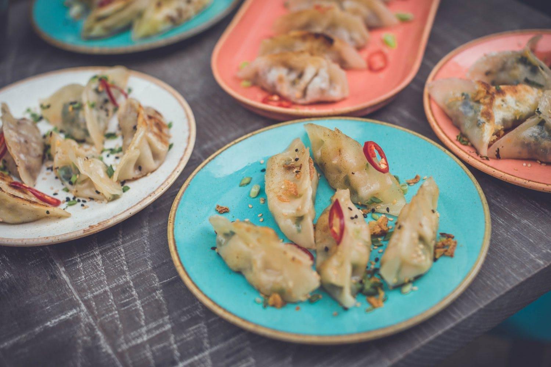 dumplings on colourful plates