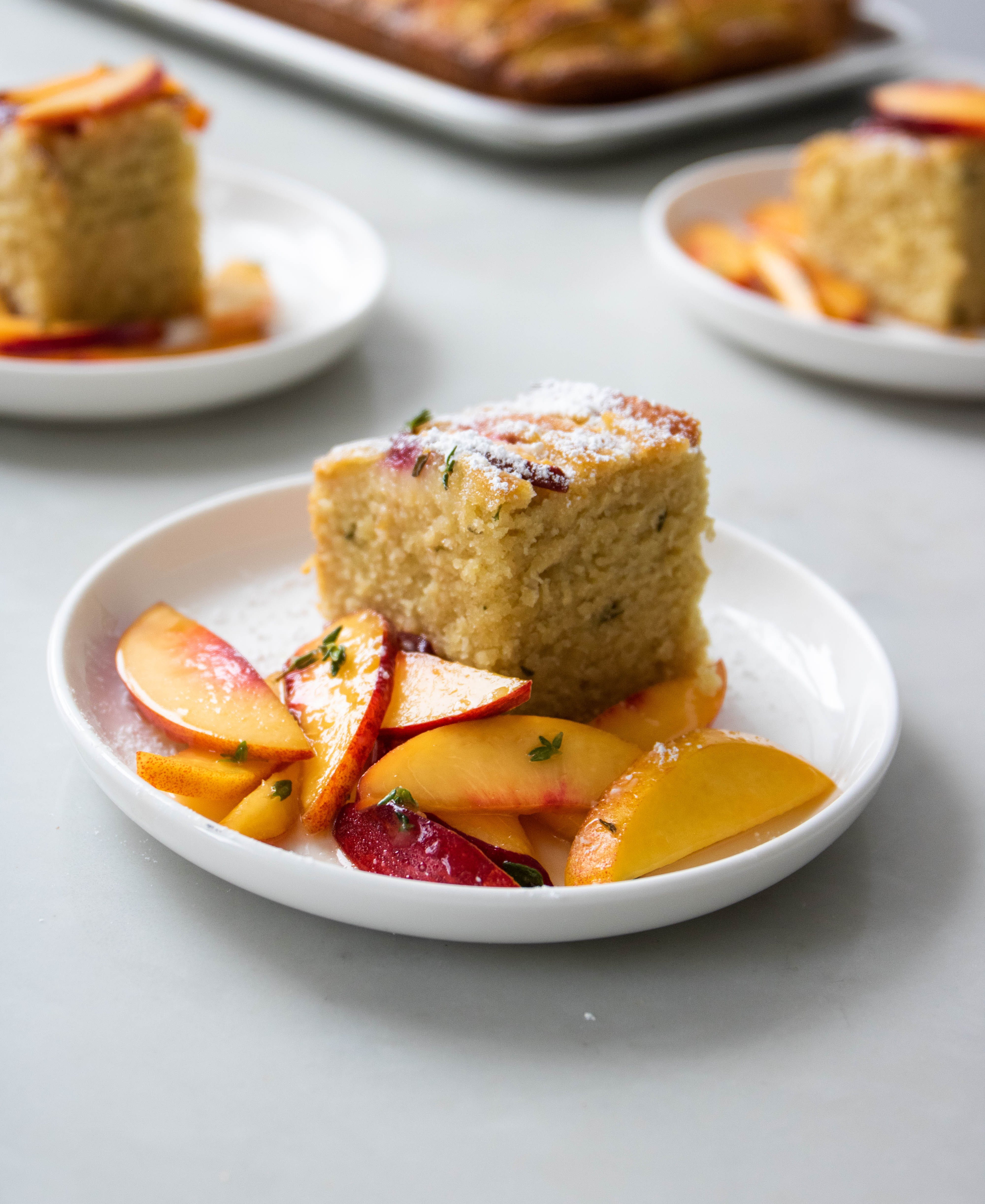 cake with peaches on plate
