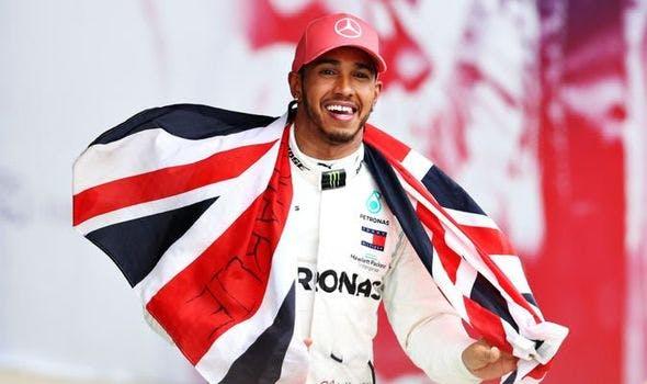 Lewis Hamilton holding British flag