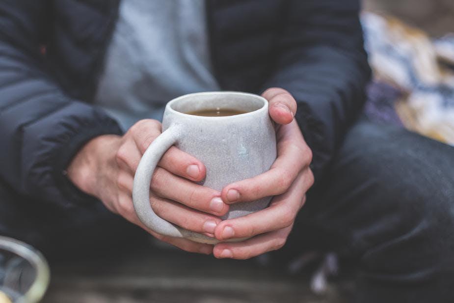 man holding tea