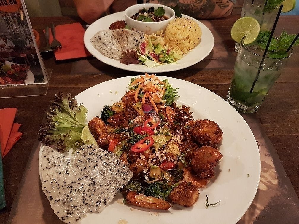 vegan chinese meals on two plates on table