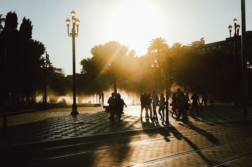people in a sunny square