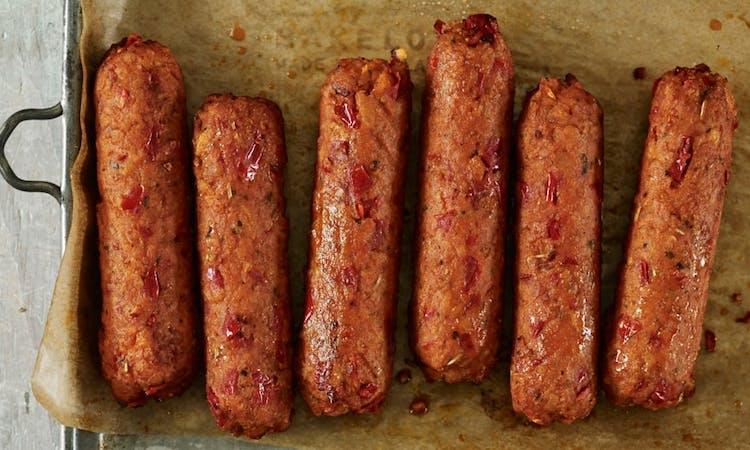 Vegan sausages on tray