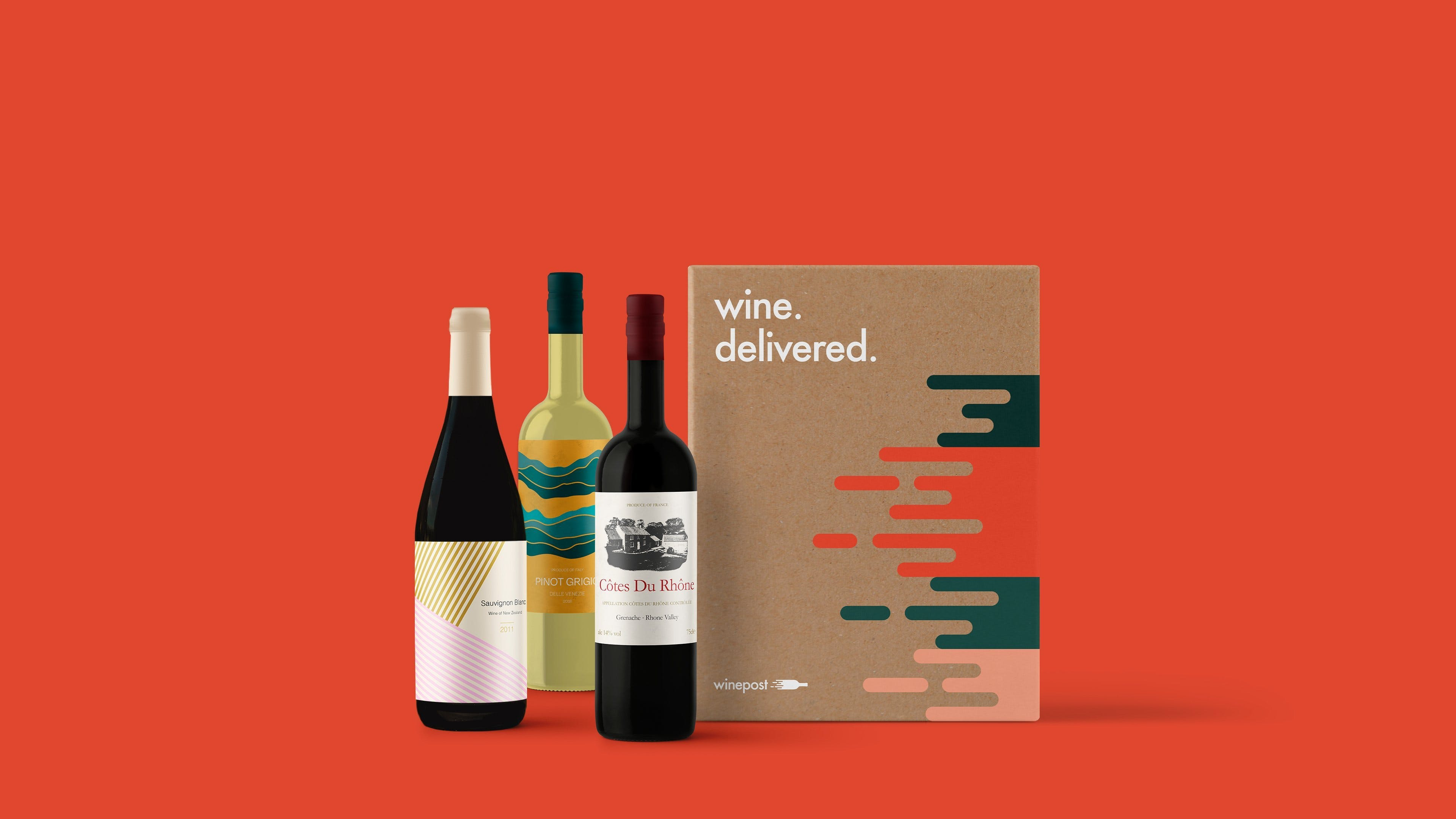 3 bottles of wine next to box with red background