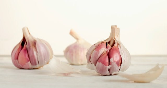 three bulbs of garlic