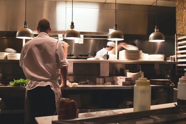 chefs in a pro kitchen