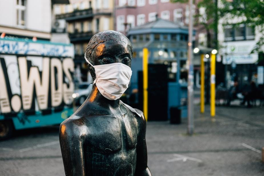 statue wearing face mask