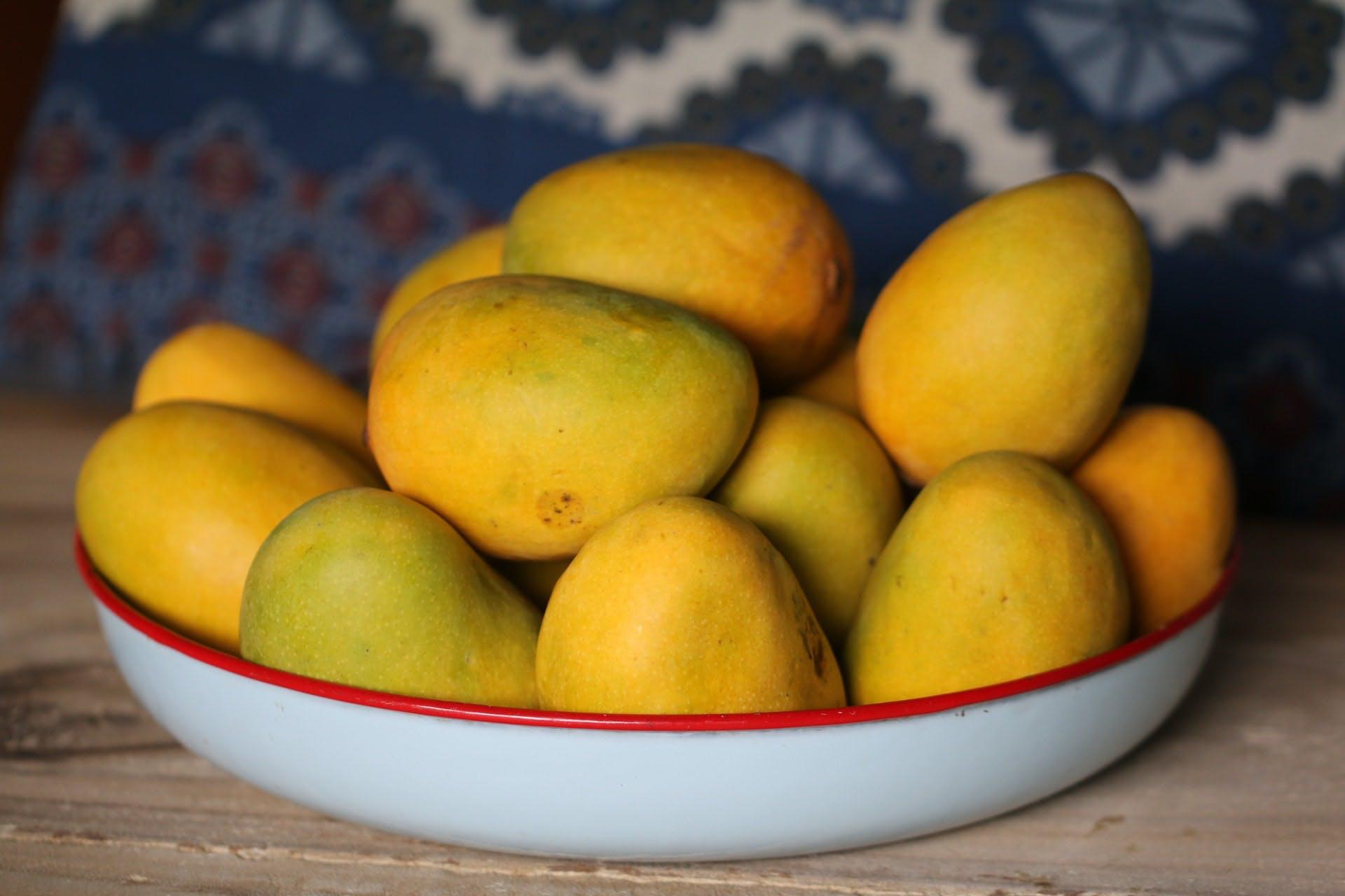 a bowl of mangoes