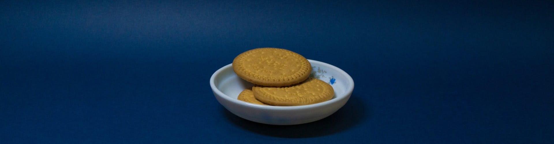 biscuits on a plate in front of a blue background