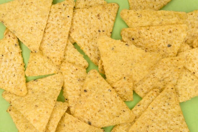 tortilla chips on green background