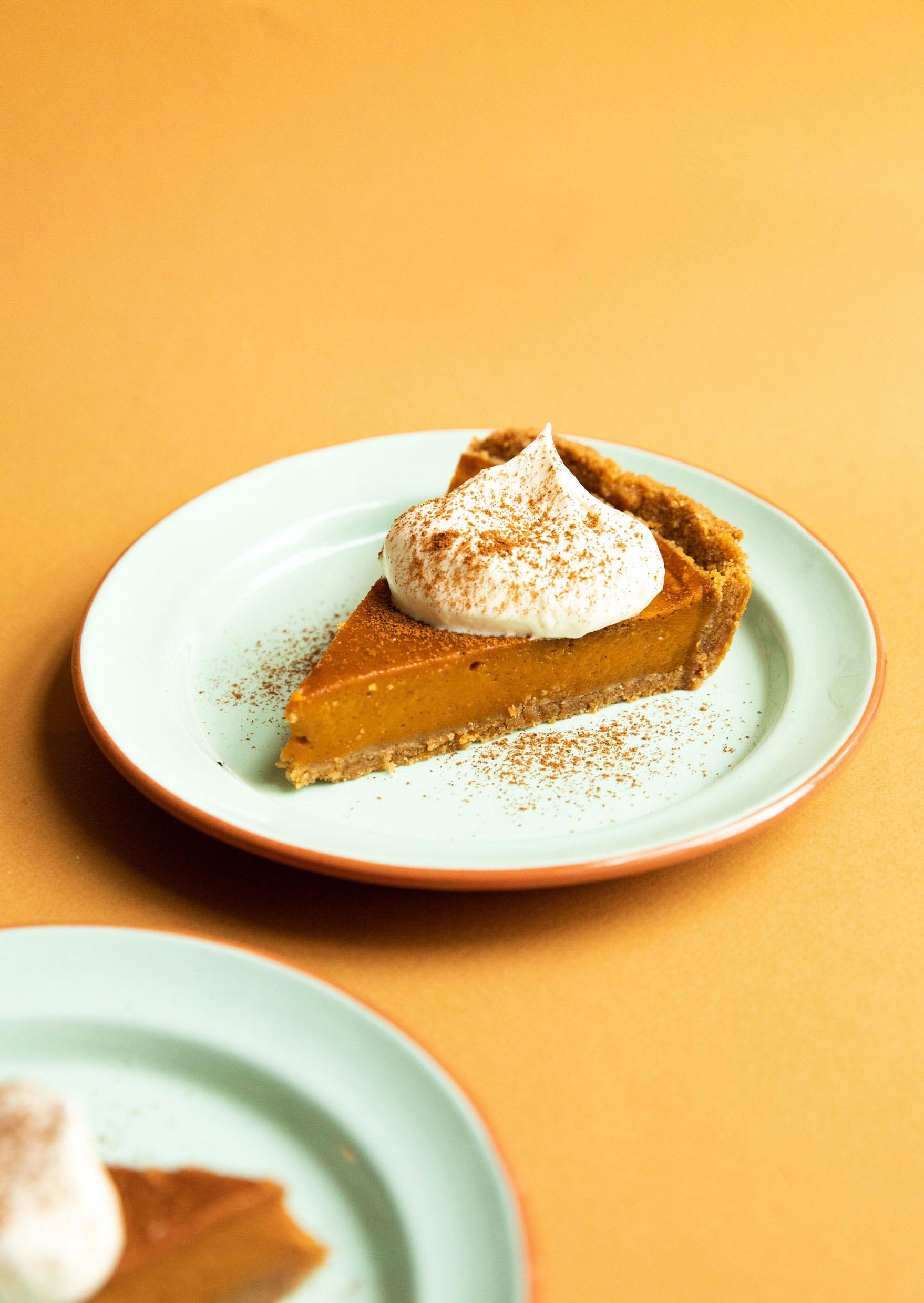 pumpkin pie slice with cream