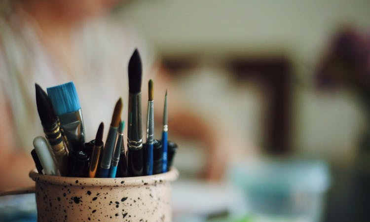 paint brushes in a pot