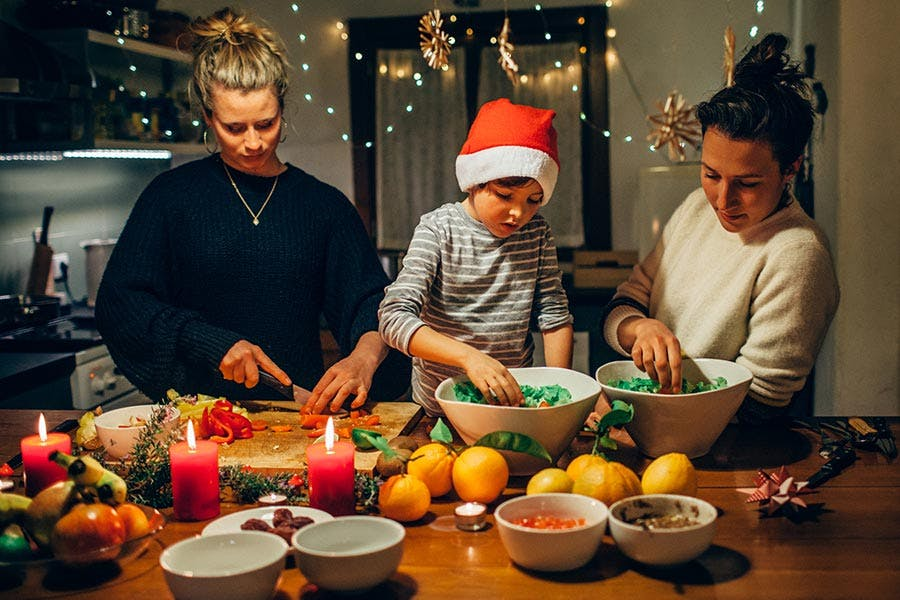 family making vegan christmas dinner