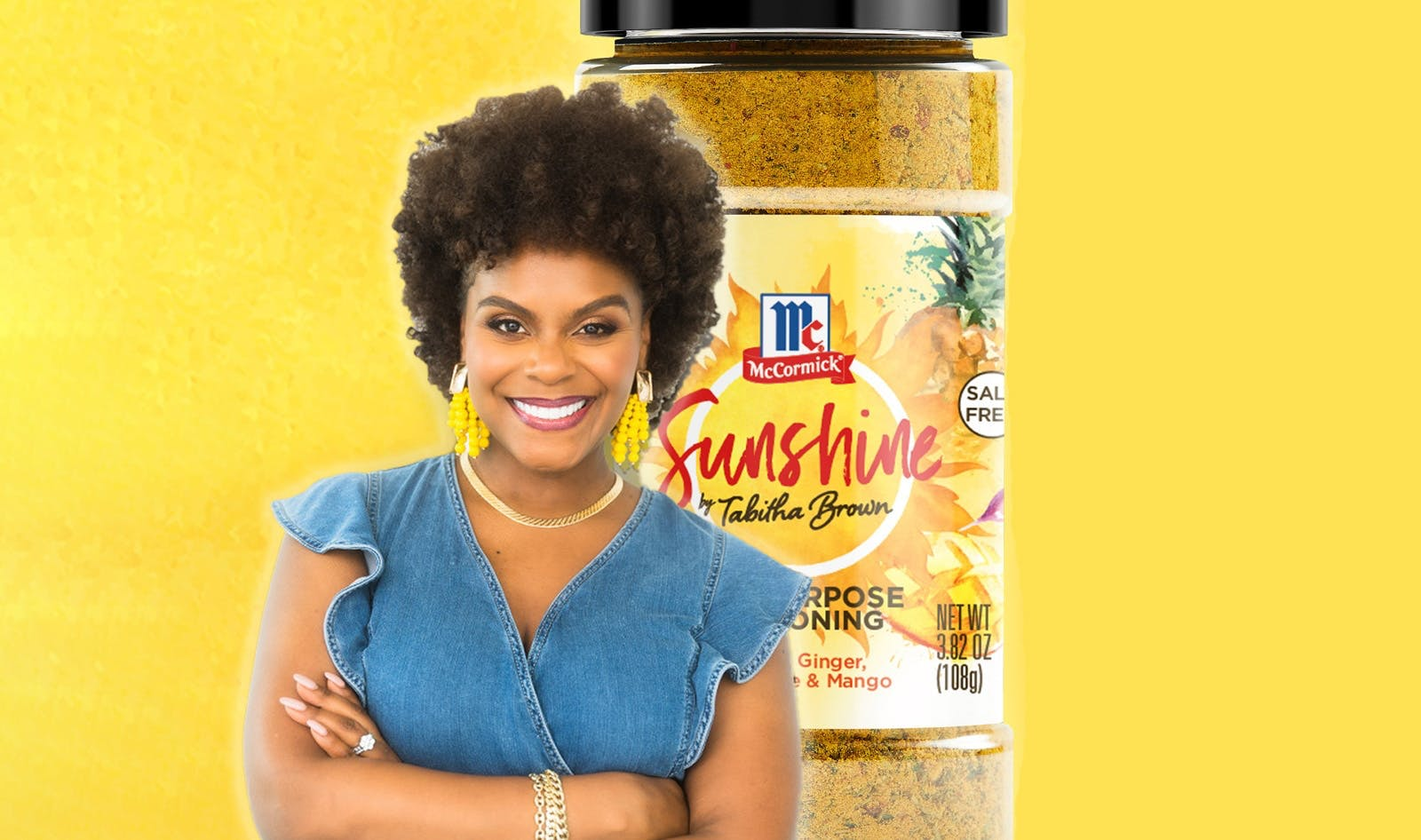 Tabitha Brown with bottle of spice blend