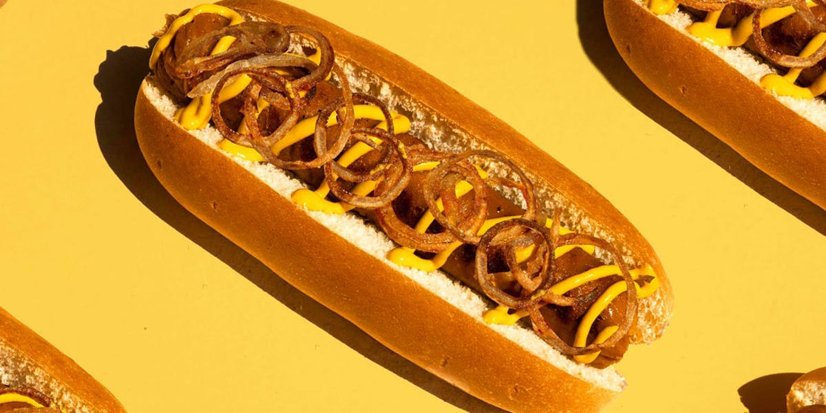 vegan hotdogs on yellow background