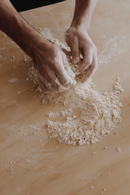 someone kneading dough