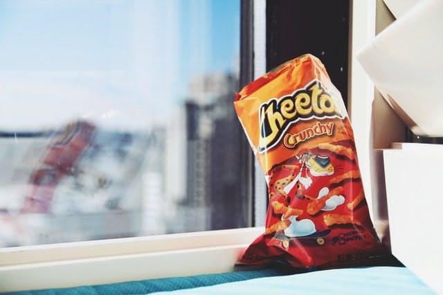 bag of cheetos on a windowsill