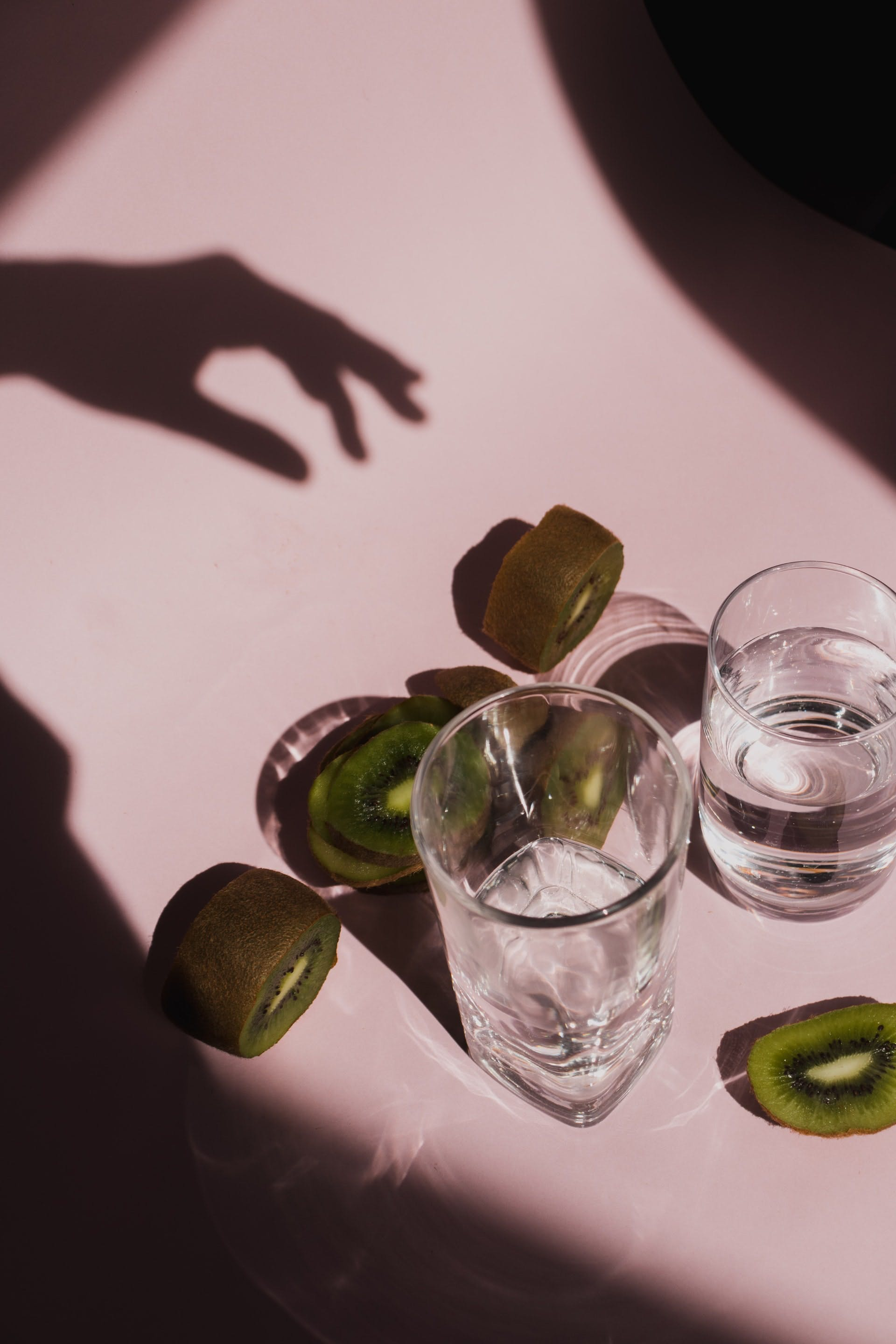 kiwi and glasses of water