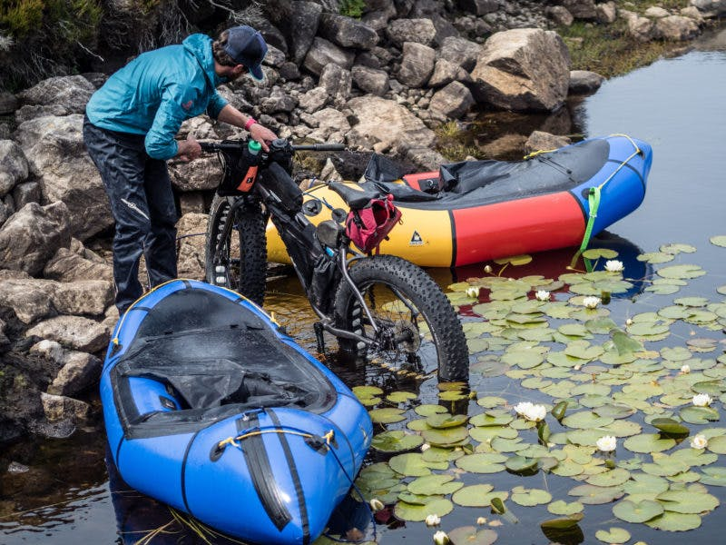 """""""Getting back on the water wasn'tt always the simplest of tasks when it meant lashing the bike to the bow in awkward spots, but this small patch of water lilies was a nice surprise to find. Shortly after this was taken I saw the craziness of trying to keep my stinky, salt-encrusted self dry and waded in. I think even the bike was glad for a chance to get all that salt washed off it after four days of sea spray!"""" Photo: Annie Lloyd-Evans"""