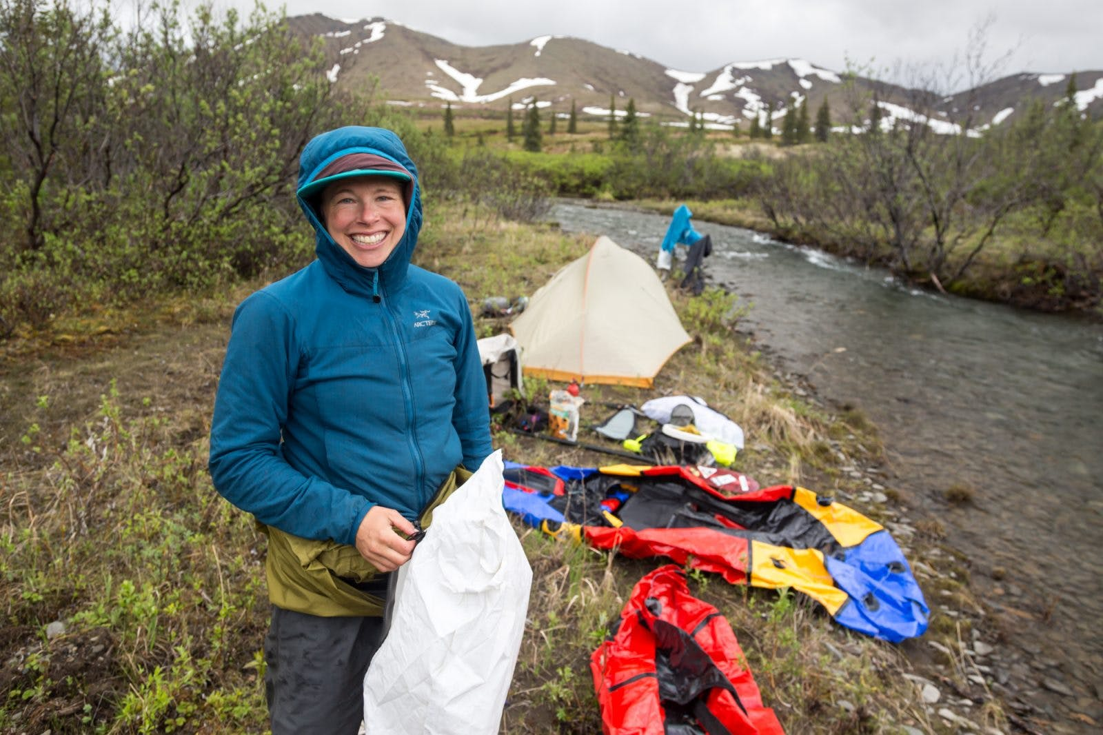 Sarah Miller Histand with her world-class smile on a backcountry packrafting trip! 📸: Luc Mehl.