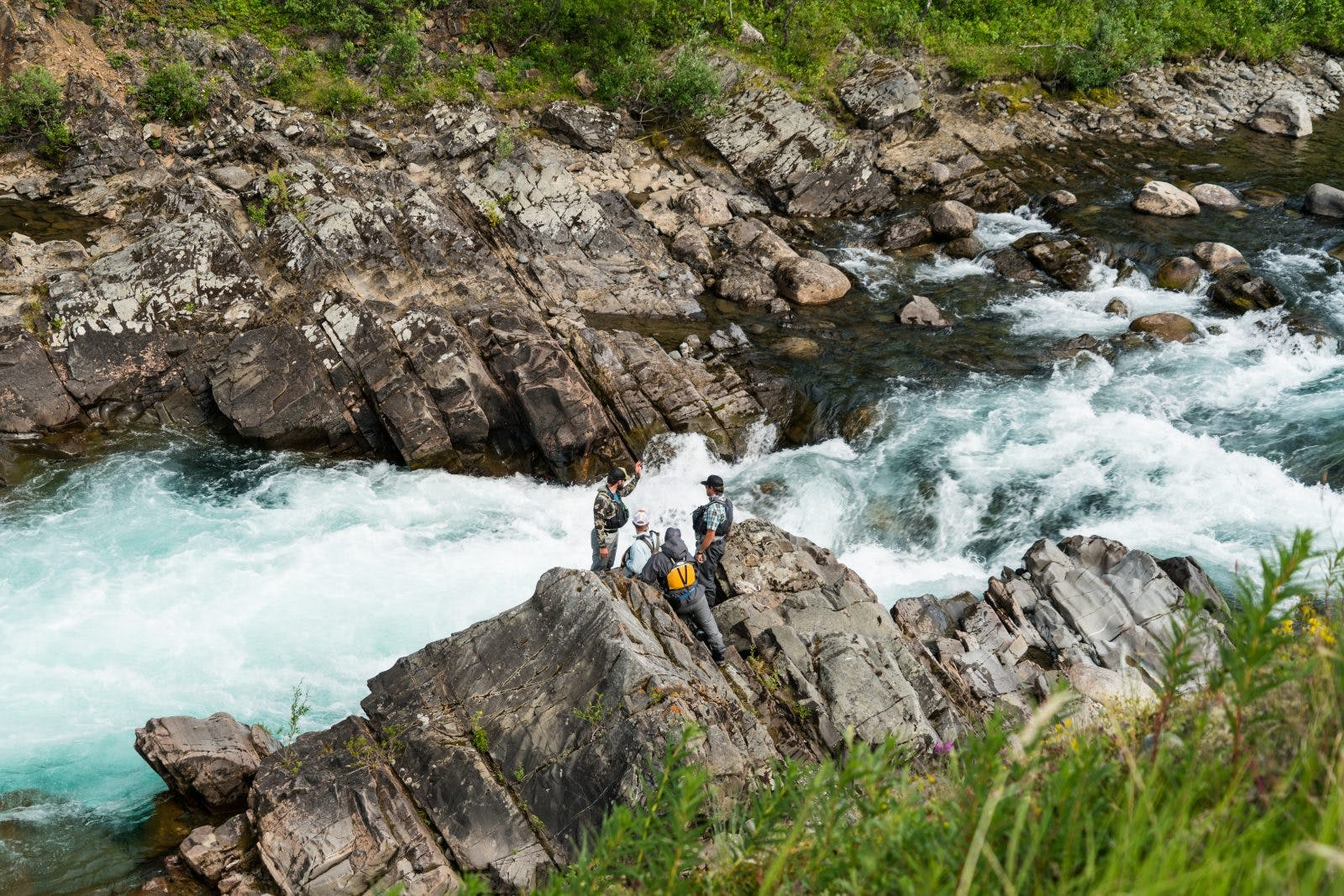Scouting rapids in Alaska. Photo by Cory Luoma of Fly Out Media.Scouting rapids in Alaska. Photo by Cory Luoma of Fly Out Media.