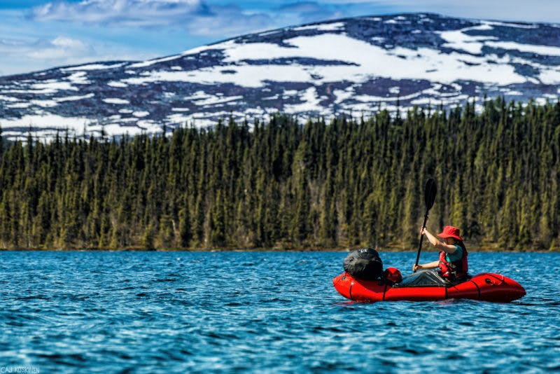 """""""This is Katja in the red packraft. I can't remember the exact places. There are a lot of small lakes you find when you paddle through the Sjaunjaälven (River of Sjaunja). Some of the lakes have Sami-name and some those have Finnish name. Finnish people started to settle to the most northern places in 1580, and they were the first people who lived in the north in same places with houses. Sami-people were in that time moving all the time, they were nomads."""" -Caj Koskinen"""