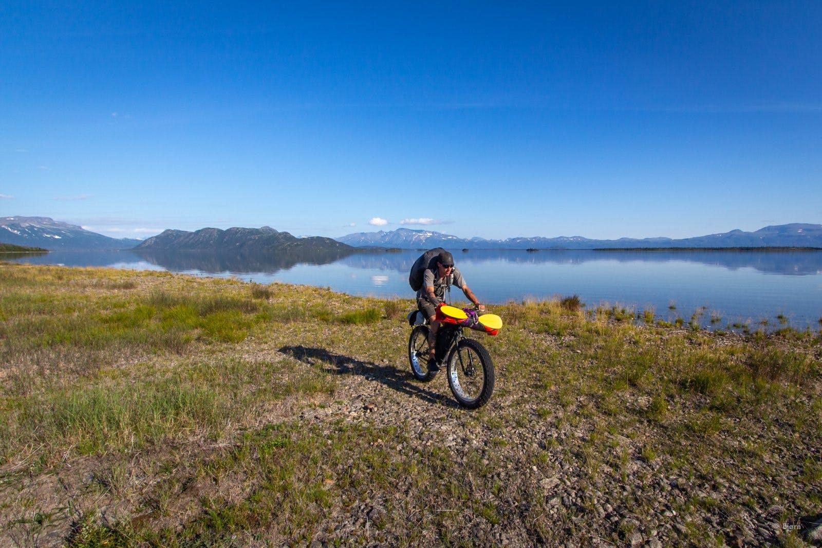 Biking along the tundra near Lake Iliamna.