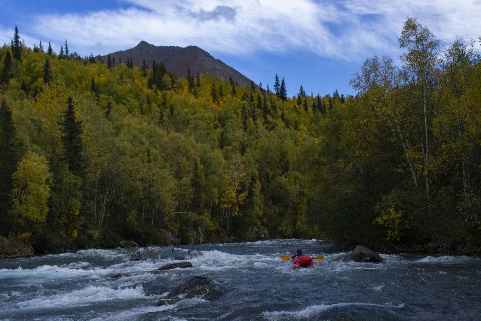Paul Gabriel on the Tanalian River in search of a place to put a temperature logger. Photo by: Sam Carter