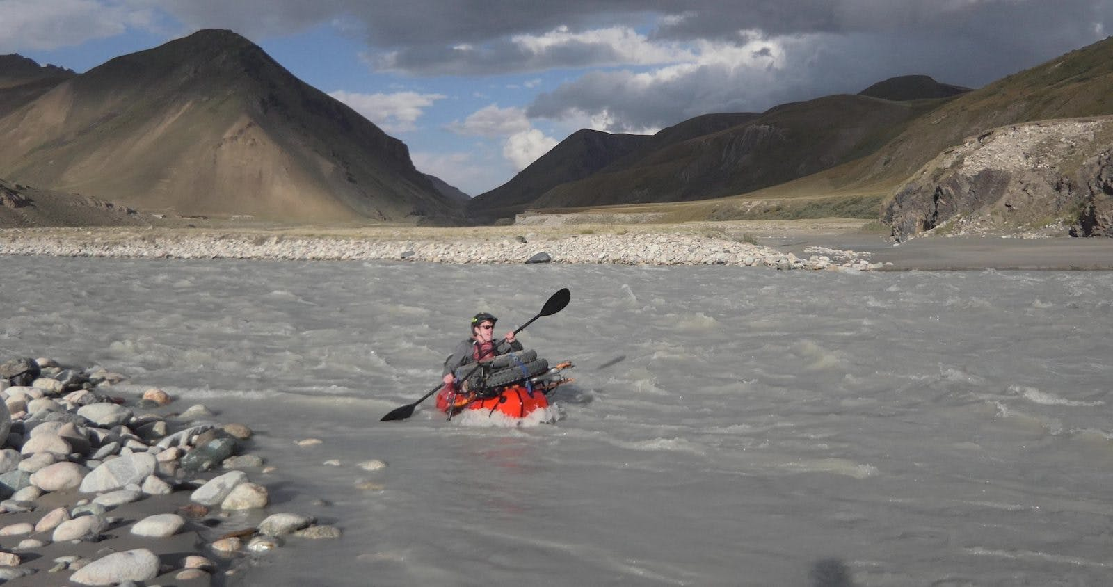 Mike McGrath pack rafting the Sary Jaz River, Kyrgyzstan.