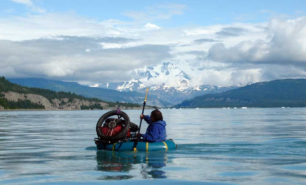 Dylan Kentch, paddling across Icy Bay (Mt. St Elias in the back) August 2008, courtesy of Sheri Tingey.