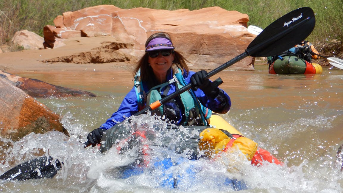 """Jennie drops through one of the many rapids that Tom described as """"pleasantly technical class 2""""."""