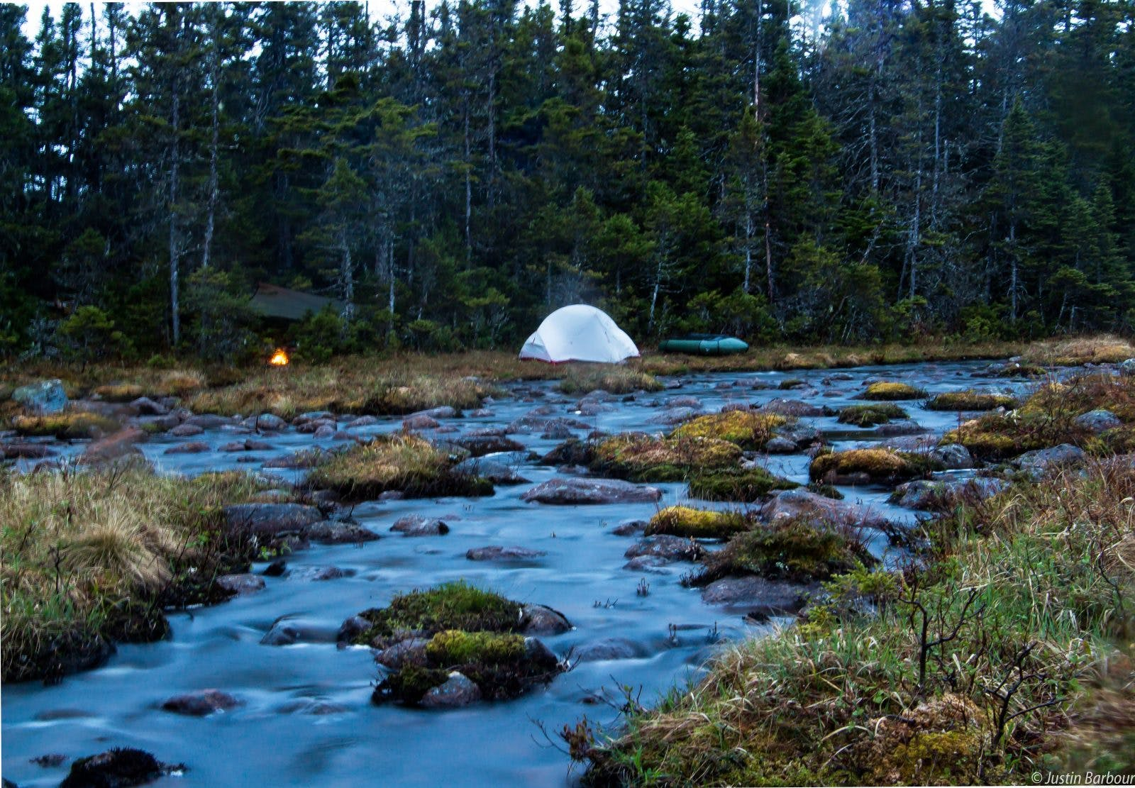 """""""Home is where ever you want it to be. Having a camp near running water is soothing and mediative. It's where I sleep the best. This photo is of the Meta Pond area in Newfoundland's Bay Du Nord Wilderness Reserve. Minus the transmission line (that I despise) in the southern extremities, this place is still very wild and remote. It is a vast 2,895 square km paradise for the outdoor enthusiast, with prime opportunities for fishing, hunting, foraging, paddling, hiking, observing wildlife, and just living the dream. In my travels there I have seen very little sign of human disturbance. Let's try and keep it that way."""""""