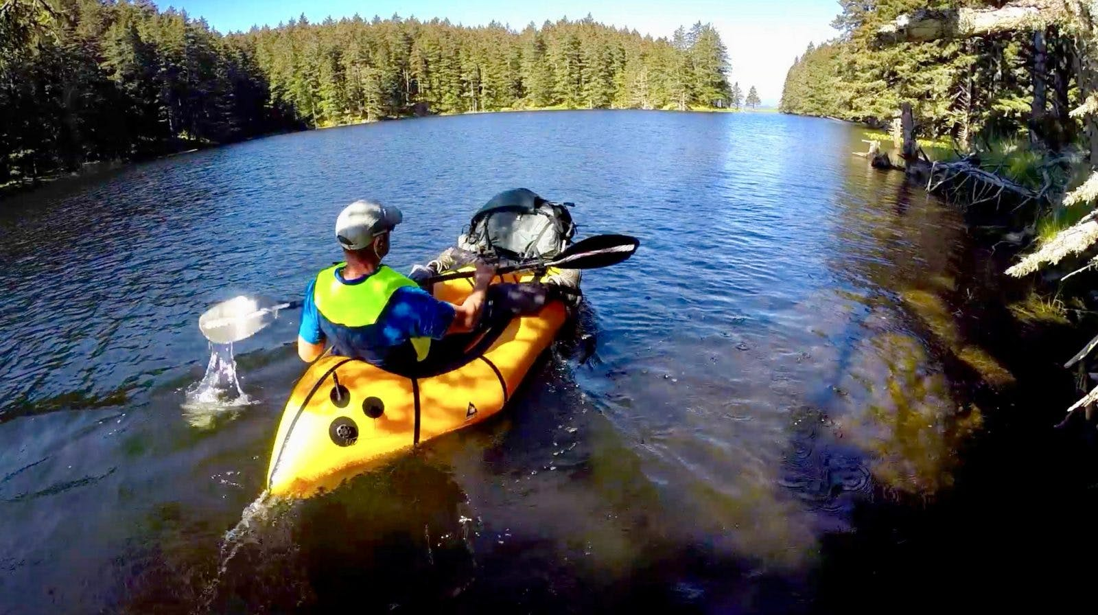 Paddling across a small lake that bisects the south end of Long Island, off the coast of Kodiak Island, Alaska. When the devil's club gets thick and you find a nice lake that offers a way around it, blow up your raft. ;^)