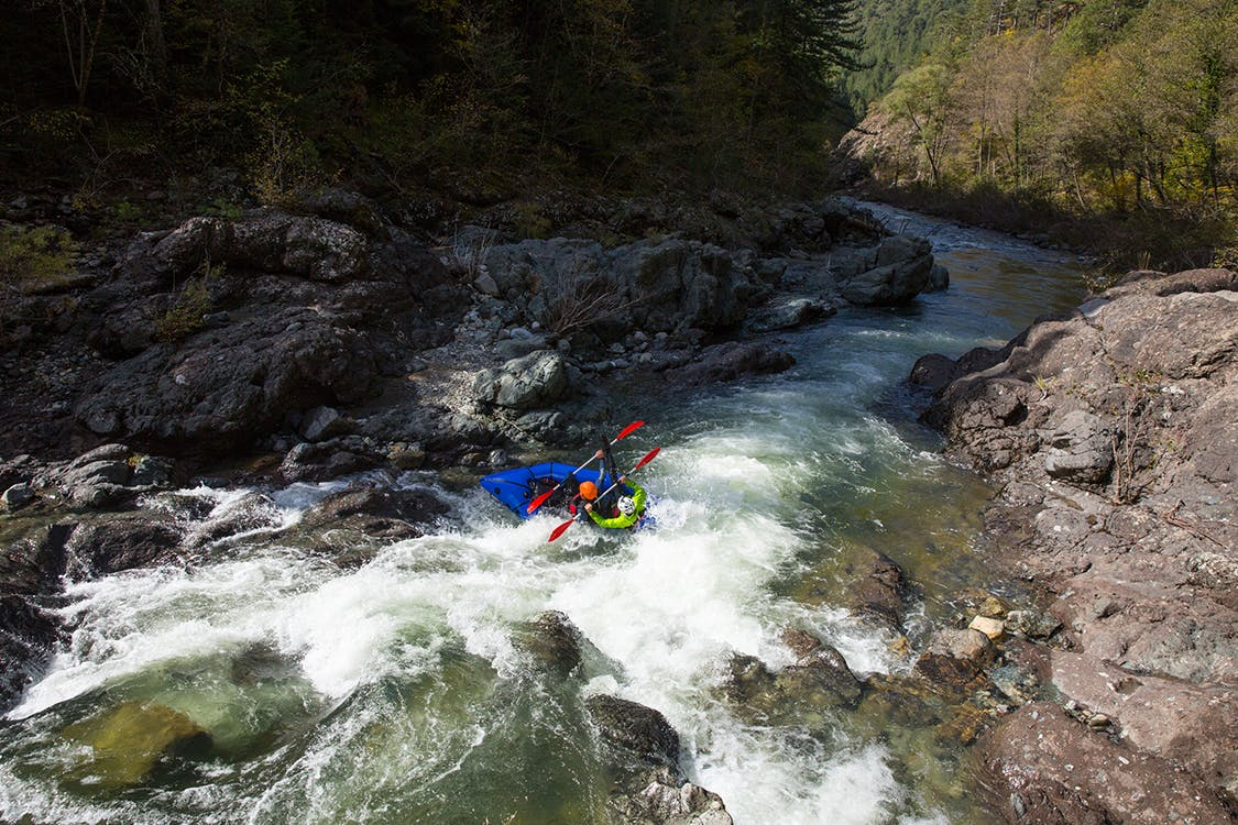 The Belgiums hitting a vigorous eddy line (and then shortly thereafter bailing), Aoos River, Northern Pindos National Park, Greece. Photo by Andrew Burr