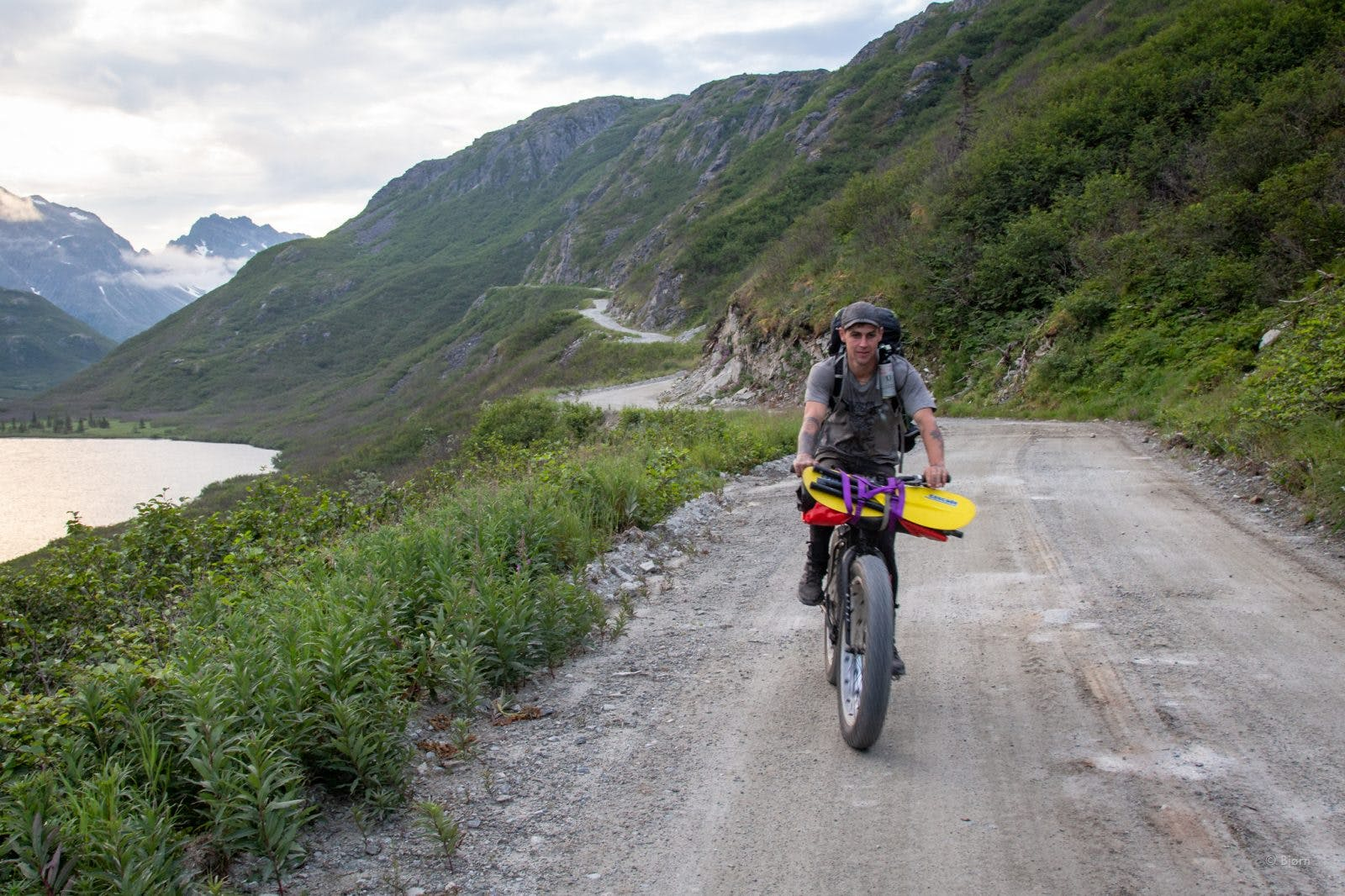 Brent biking the Pile Bay-Williamsport Road from Cook Inlet to Lake Iliamna.